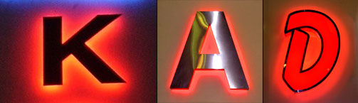 Large letters illuminated from both the front and the back.