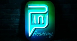 """""""Pin academy"""" Custom neon sign on printed background"""
